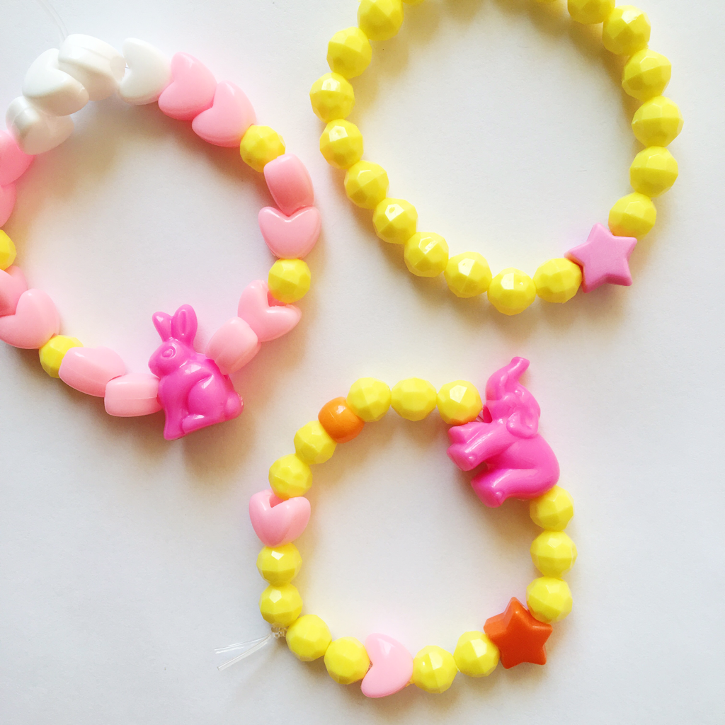 playing with beads - child activity - toniadee.com